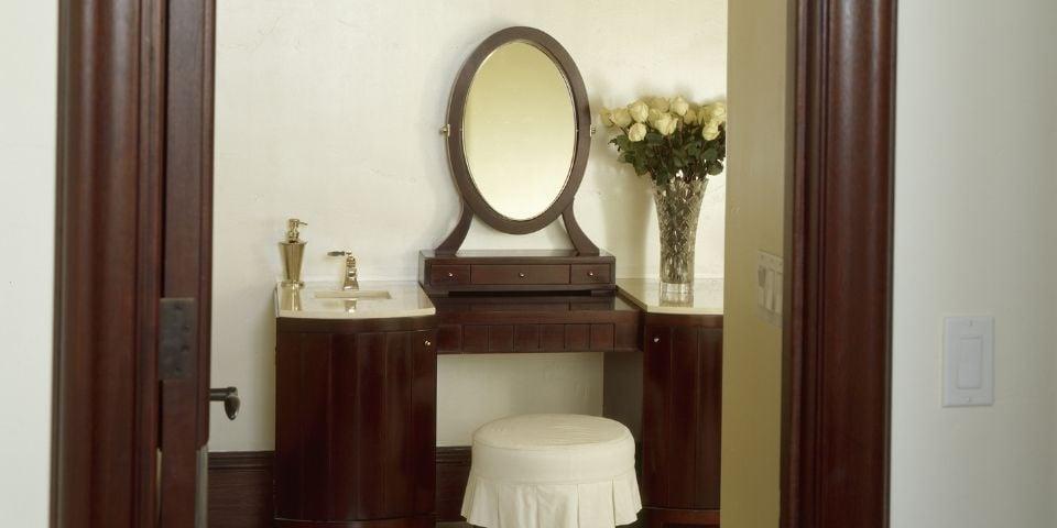 A dark, hardwood vanity located in a bathroom