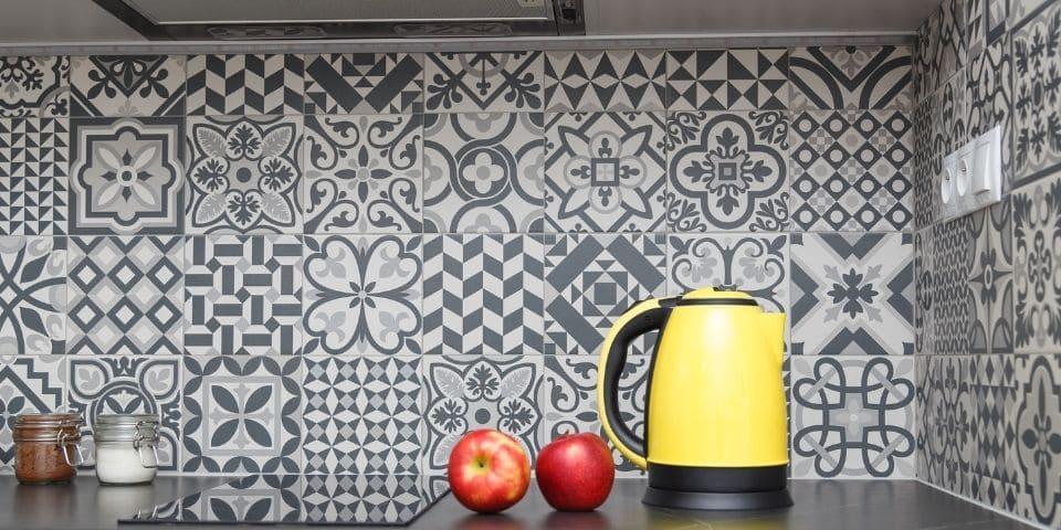 busy patterned black and white kitchen tile backsplash