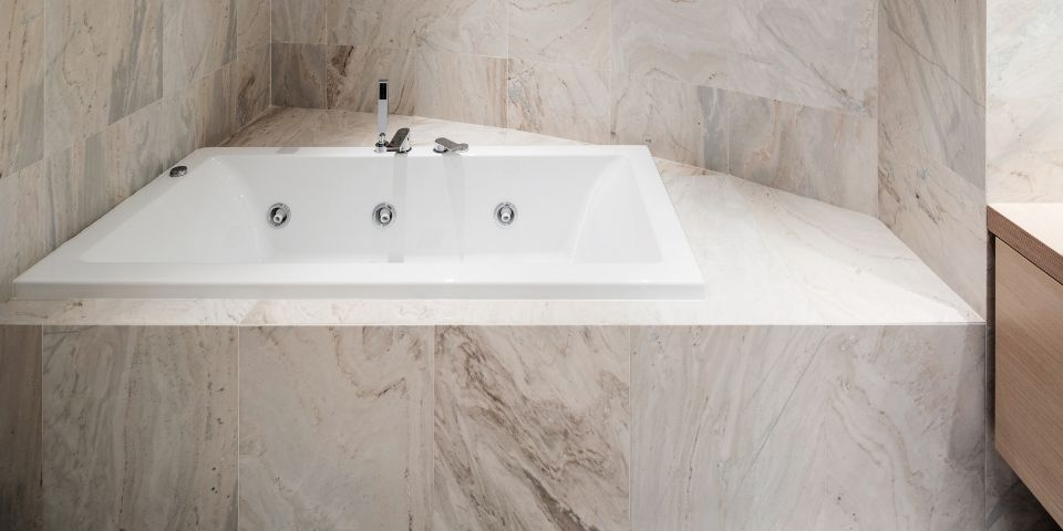 marble accented jacuzzi tub in master bath suite