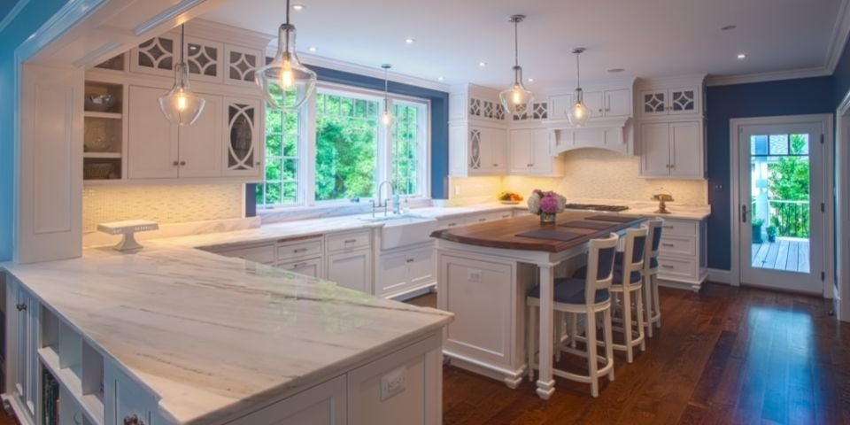 modern blue and white kitchen large windows looking outside