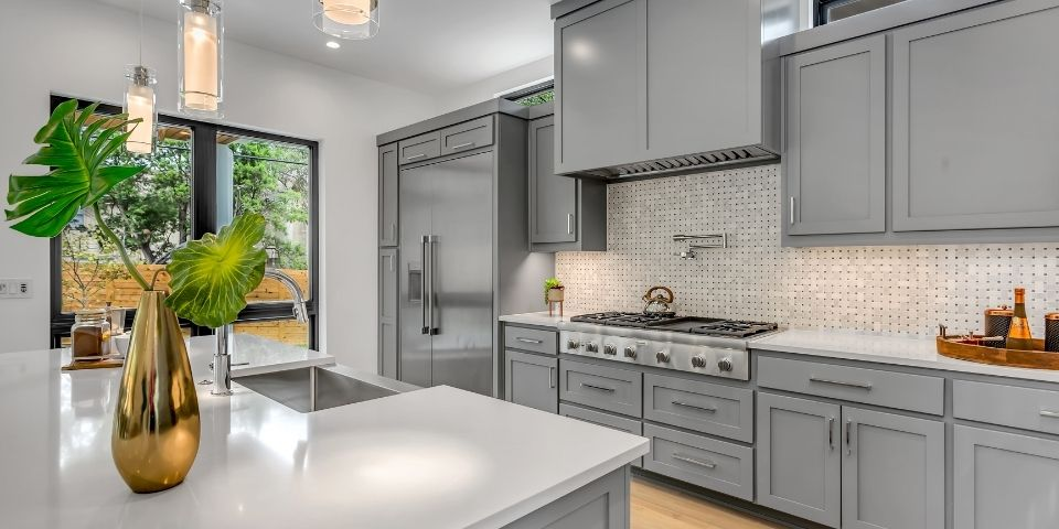 modern gray and white kitchen with shaker style cabinets
