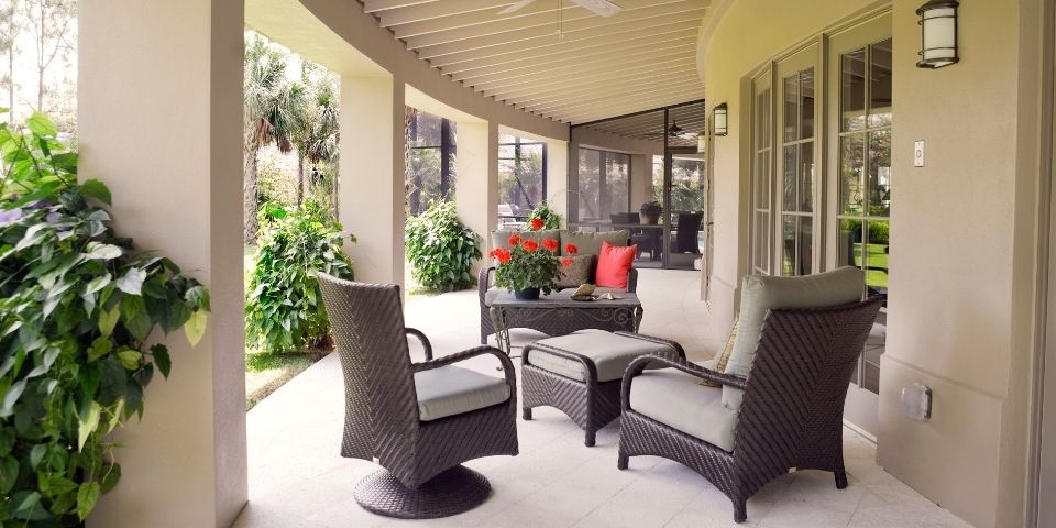 outdoor patio living space with dark brown patio furniture