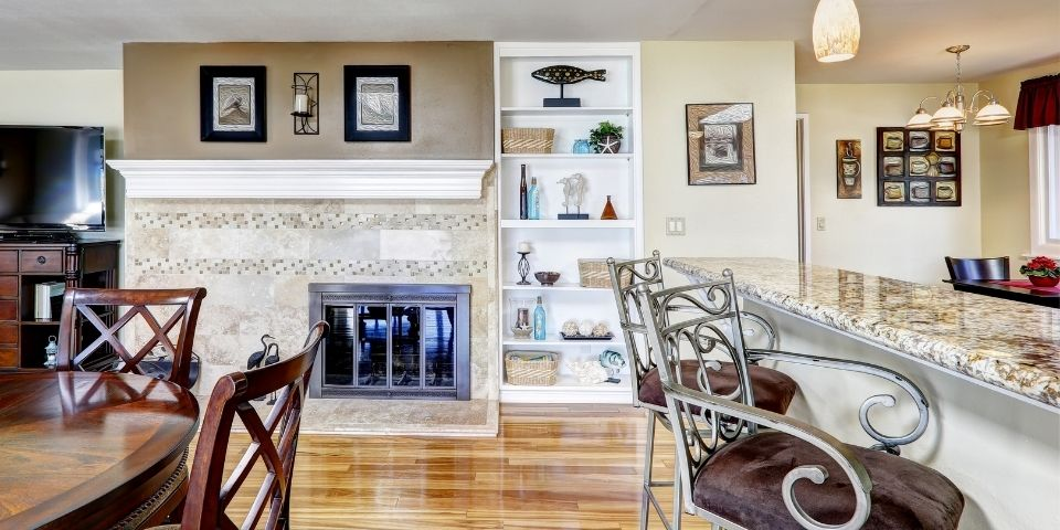 simple fireplace in the kitchen and dining space