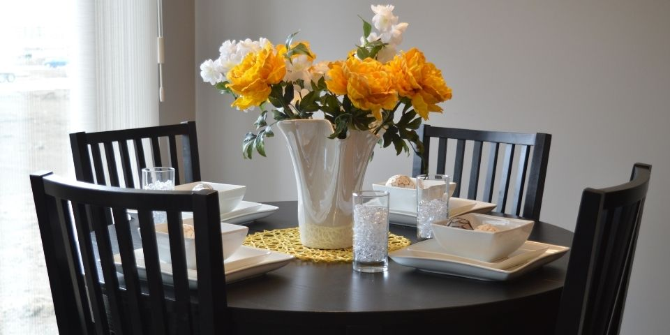traditional dining table space with dark table and flowers in the center