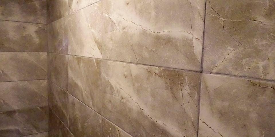 brown ceramic tile bathroom wall