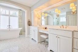 Bathroom Remodeling Services Modern Bathroom Tile Flooring Freestanding Tub and Custom Cabinetry Vanity | Denny + Gardner Design-Build Remodelers
