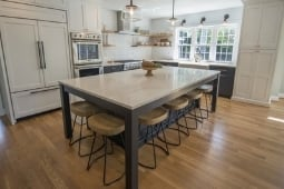 Kitchen Remodeling Services Large Eat-In Island with Custom Built-In Appliances | Denny + Gardner Design-Build Remodelers