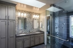 Bathroom Remodeling Services Tile Backsplash Accent Wall with Custom Vanity Sinks and Walk In Glass Shower | Denny + Gardner Design-Build Remodelers