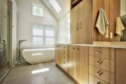 Bathroom Remodeling Services Modern Bathroom Design with Freestanding Tub and Wood Cabinetry | Denny + Gardner Design-Build Remodelers