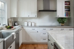 Kitchen Remodeling Services Farmhouse Sink with White Cabinets and Subway Tile Backsplash | Denny + Gardner Design-Build Remodelers
