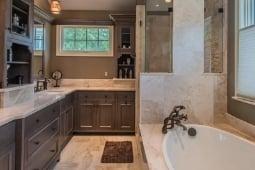 Bathroom Remodeling Services Modern Luxury Bathroom with Tub and Glass Door Tile Shower | Denny + Gardner Design-Build Remodelers