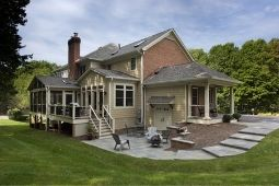 Exterior Home Addition on Beautiful Brick Home with Patio - Home Addition Services | Denny + Gardner