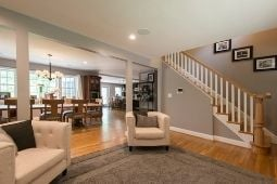 Interior Whole Home Remodel Stair Railing and Open-Concept Floor Plan - Whole Home Remodeling Services | Denny + Gardner