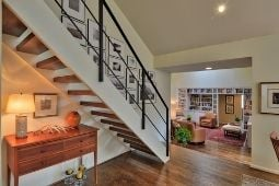 Interior Whole Home Remodel with Modern Stair Railing and Open Stairs with Step-Down into Living Area - Whole Home Remodeling Services | Denny + Gardner