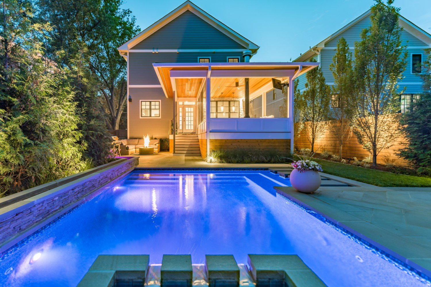 award-winning-patio-at-night-with-pool